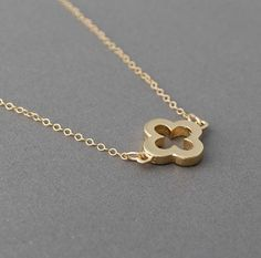 Thicker Gold Clover Necklace Quatrefoil also available in sterling silver. $26.00 USD, via Etsy.