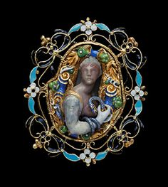 The oval gold frame, enamelled with white, sky and dark blue trails of flowers and leaves surrounds a bust of Cleopatra, head and bust in agate, blue snake coiled around her right arm and hand, facing towards the front, within an inner border of fruit and flowers. 16th century.