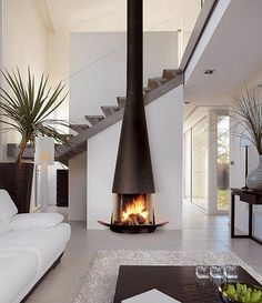 Graceful yet simple shape of the fireplace. Centre of attention but not screaming!