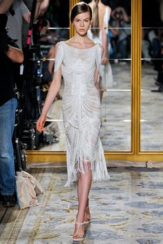 Marchesa Spring 2012 collection. Channeling a little Gladiator meets Roman Goddess in this hot white fringed dress. Fringe is a hot trend for 2012!!