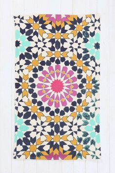 Could be a great bright base for a hot pink, navy and gold cube. Magical Thinking Flower Tile Printed Rug - Urban Outfitters