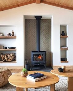 this scandinavian inspired cabin exemplifies natural home design, making our rustic thin brick tile the perfect pick for this fireplace surround. shown: clé foundry flats thin brick subway tile in sand cast. #cletile #subwaytile #brick #fireplace #herringbone