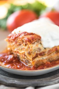 This Million Dollar Lasagna is the best easy lasagna recipe out there! Change up the fillings however you'd like- this version is layered with flavorful Italian sausage, marinara and Alfredo sauce. And no boiling noodles Best Easy Lasagna Recipe, Easy Lasagna Recipe With Ricotta, Classic Lasagna Recipe, 7 Layer Lasagna Recipe, Lasagna With Cream Cheese, Sausage Lasagna, Meat Lasagna, Lasagna No Boil Noodles, Gourmet