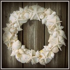 Pretty seashell wreath, perfect for a nautical party.