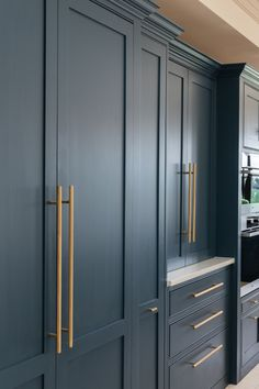 So much storage here in our Potters Bar project. Built-in larders with worktops, and even a utility that is made into a walk-in pantry. Shaker Style Kitchens, Shaker Kitchen, Large Blank Canvas, Tall Cabinet Storage, Locker Storage, Kitchen Triangle, Pantry Cupboard, Shaker Furniture, Set Of Drawers