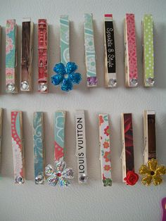 Decorate clothes pins, then glue small magnets to the back to put on the fridge. Cute!