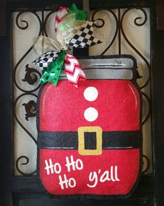 Santa suit theme mason jar, burlap door hanger. Hand painted Christmas door decor by ConnieRisleyCrafts on Etsy https://www.etsy.com/listing/250263201/santa-suit-theme-mason-jar-burlap-door
