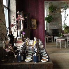 A tea shop. i like the tea display, the wood, the colors, and the hanging plants