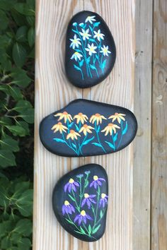 You'll receive the same three hand-painted rocks with flowers seen in the pictures and video. These natural stones are painted on the front and sides while the backs are left in their natural state. Painted Rocks For Sale, Hand Painted Rocks, Unique Housewarming Gifts, Garden Stones, White Flowers, Picture Video, Etsy Store, Natural Stones, House Warming