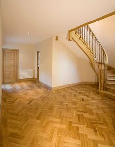 Solid European Oak parquet laid in a double-herringbone pattern with a border, plus matching skirting and spiral staircase. Parquet Flooring, Wooden Flooring, Vinyl Flooring, Floors, Wooden Skirting Board, Floor Skirting, Pine Bed Frame, Pine Beds, Oak Doors