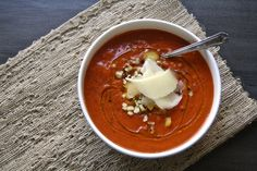 a traditional spanish gazpacho:  roasted red pepper and tomato with corn and manchego