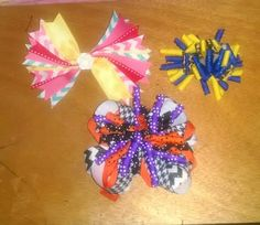 Blue and gold bow $2.00 Spike bow $3.00 Orange, purple and black bow $3.00