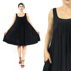 Achieve style perfection in this modern bohemian trapeze tent dress. Pleated at the bustline, its got a super full shape and is made from black