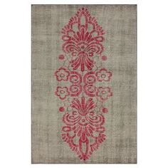 Hand-knotted wool and art silk rug with a damask-inspired motif.     Product: RugConstruction Material: 85% Wool and 15% ViscoseColor: Pink and greyFeatures:  Hand-knottedMade in India Note: Please be aware that actual colors may vary from those shown on your screen. Accent rugs may also not show the entire pattern that the corresponding area rugs have.Cleaning and Care: These rugs can be spot treated with a mild detergent and water.  Professional cleaning is recommended if necessary.