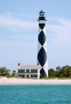 Cape Lookout Lighthouse. Traveled to this one, beautiful island! Went by boat, Anchored out a ways and stayed overnight.