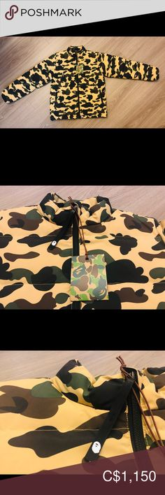 NWT HTF LE A Bathing Ape BAPE Puffy Bomber Jacket Men's in Small. Brand new and never used. Bought directly at a BAPE store in NYC, USA.  Yellow camo colour. New with tag. Hard to find. Limited edition. No longer sold in stores or online. Bape Jackets & Coats Bomber & Varsity Bape Jacket, Bomber Jacket Men, Bape Store, Camo Colors, A Bathing Ape, S Man, Nyc, Brand New, Coats