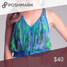 🎉Host Pick 🎉 2/15 Bebe Fringe top Great top for a night out 🌺 Cropped tie dye effect top with fringe bebe Tops Crop Tops