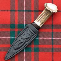 "Sgian duh or ""black knife on McGregor ""modern"" tartan - in case you were wondering what a sgian duh looks like when you read about one in my books."
