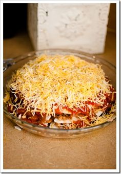 taco pie - layered tortillas, refried beans and ground beef/turkey - top with salsa and cheese and bake - yum!