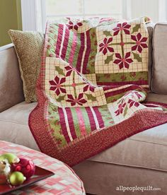 Fusible appliqué and strip piecing make the seasonal throw an easy project to finish quickly—just in time for gift-giving.