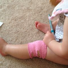 Homemade knee pads out of an old toddler sock. 3 slits in the back for flexibility. A 20 second project.