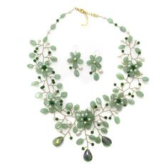 Incorporate some sweet floral elements into you style with this jewelry set from Thailand. This jewelry set features a gorgeous mix of freshwater white pearls and thai jade gemstones.
