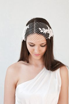 The bridal veil in bandeau style made of french veiling and delicate floral lace can be used in two way - as a bandeau veil covering the eyes