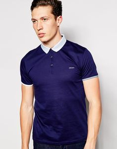 "Polo shirt by DKNY Soft-touch jersey Knitted collar Three button placket Embroidered logo Fitted cuffs Regular fit - true to size Machine wash 100% Cotton Our model wears a size Medium and is 188cm/6'2"" tall"