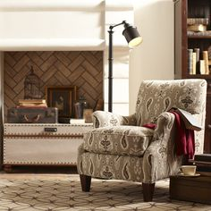 Clayton Chair | The Clayton chair lends an air of cozy whimsy to any room. Curving arms sweep and flare, the perfect contrast to a neatly tailored back and block tapered legs. Available in a natural-colored blended cotton fabric or an ikat-style paisley print in shades of tan, cream, and brown.