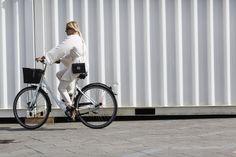 Biking in Copenhagen, via Vogue.com