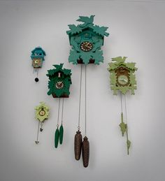 My obsession with clocks: meet my obsession with birds. ...aaaand my love for all greens/blues. This is FAB!! Image by Tereasa Surratt of a Very Modest Cottage http://averymodestcottage.blogspot.com/2011/01/cuckoo-clock-installation.html (And by the way? That rocking chair? SWOON!)