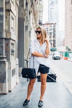 Linda Juhola in New York in shirt dress from Mango, black leather shorts from Twist & Tango, Ray Ban sunglasses, Chanel bag and black loafers by Whistles