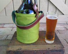 Insulated Bag for 64oz Craft Beer Growler   Handmade in Pennsylvania with love.  Fits most 64 oz growlers. Red canvas exterior and felted wool