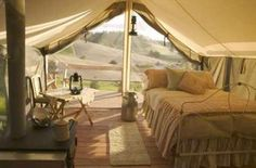 a cozy tent room with a soft bed.
