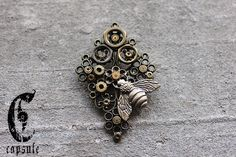 30.00$ Bronze Steampunk Brooch with Bee, Antique Vintage Watch and Clock Nuts, Ruby Jewels, Gears and Cogs, on a Filigree Metal Base  https://www.etsy.com/ca/listing/218599555