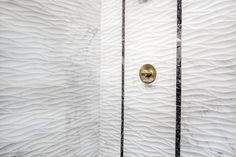 Illuminate beauty in waves with this white Carrara marble bathroom shower wall tile. With subtle grey speckling and veining features, Hampton Engraved marble wall tile is a modern dream come true in natural stone. https://www.tileshop.com/product/650027.do