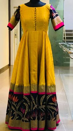 Ikkat dresses - Stunning mustard color floor length dress with pattu boarder Sold Price 5000 INR To order whatsapp 7013728388 Long Gown Dress, Sari Dress, Anarkali Dress, Saree Gown, Long Dresses, Long Frock, Lehenga Blouse, Anarkali Suits, Indian Designer Outfits