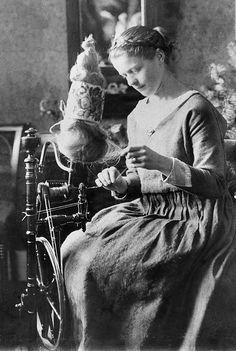 Woman spinning yarn in Copenhagen, ca. 1900