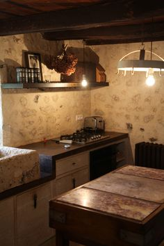 Le Logis de Puygaty: The guest cottage kitchen. But you don't need to cook. Pierre does that for you.