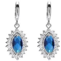White Gold Plated Marquise Blue Stone Hoop Earring White Gold Plated Marquise Cut Blue Color Stone Hoop Earrings. Blue Sapphire Color,  White Gold Plated Brass. Love these! Wore for a wedding once. I no longer need them. Can be dressed up or down! Jewelry Earrings