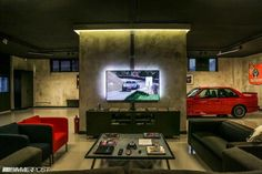Ulimate Garage/Man Cave Want to mount your TV as cool as here? Get a wall mount for it! Whats better than having your car in your man cave. Man Cave Rules, Man Cave Wall, Man Cave Room, Man Cave Diy, Man Cave Home Bar, Cave Bar, Car Man Cave, Garage Loft, Garage Metal