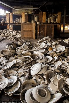 Plates are seen piled up at Shenango ceramics, one of the leading American dinnerware manufacturers from the 1920's until the late 1980's, i...