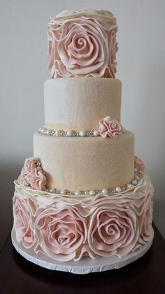 This is the cake that I want - The rosettes are a pink ombre. Best part - the middle layers are encrusted entirely in sanding sugar and dusted with edible glitter... #bestweddingcakes