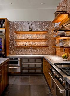 "copper in the kitchen - statement wall is ""tiled"" with pennies"