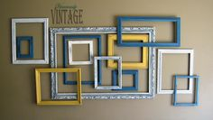 very possibly a future project for our family room - love this layered look with various frames