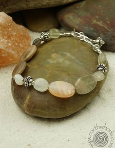 Peach moonstone and sterling silver bracelet by EarthWhorls.  https://earthwhorls.com/collections/bracelets/products/3096sb