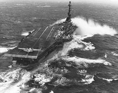 """USS """"John F. Kennedy"""", one of the more modern carriers, is shown here ...Is this C-2 Greyhound waiting for a cat shot?"""
