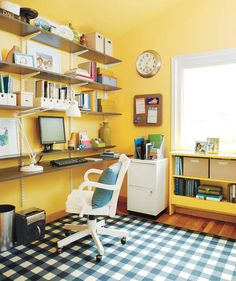 When you can't devote an entire room to a home office, save space by saying good-bye to clunky desks. Opt for sturdy shelves to house your computer and keyboard. | Trying to carve out a neat space of your own? Find inspiration in these photos.