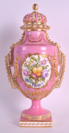 A GOOD 19TH CENTURY COALPORT PORCELAIN VASE AND COVER painted in the Sevres style, to one side with a fruiting panel by William Cook, the other in the Watteauesque style. 1ft 1ins high.