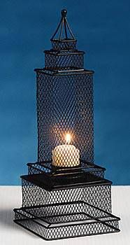 Complete the look of your city tables with this Empire Votive Candle Centerpiece. The 1 foot high metal candleholder is shaped like a city building.